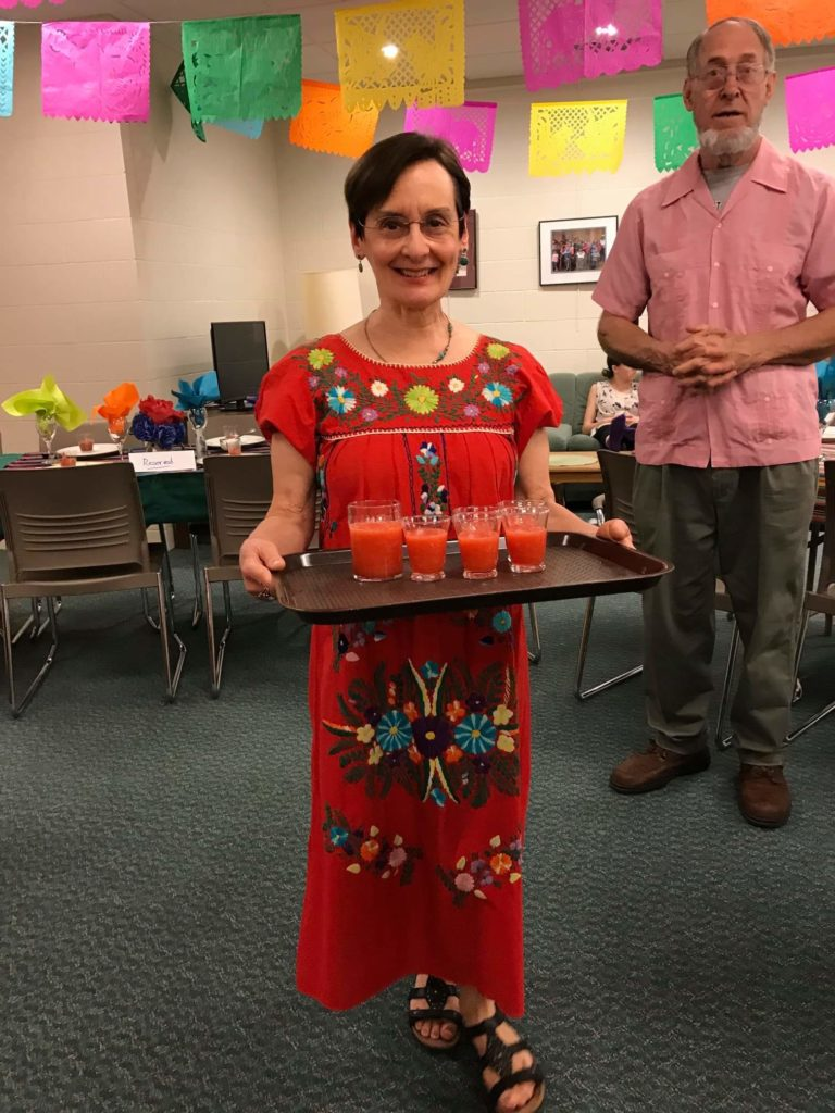 Janet E. Kurtz serving Aguas Frescas at the First Congregational Church's Mexican Night, May, 2019.