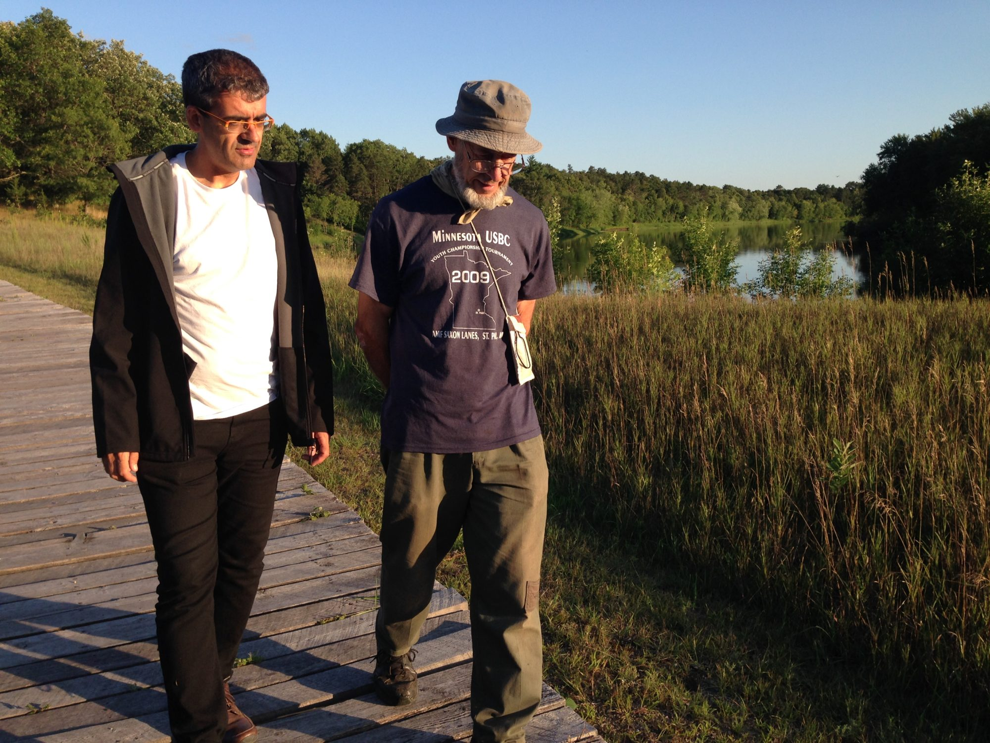 Alberto and Robert on the boardwalk along the Mississippi River at the Crow Wing Park Town Site, 2019