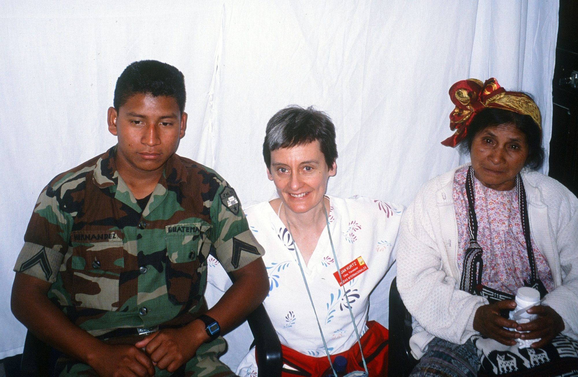 Jan working as translator for HELPS International in Barillas, Guatemala. The military man spoke Spanish and Kojobal (Mayan dialect) enabling communication with the Mayan elder. (2003)