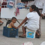 """Vendors often have their children near. Here we have an ingenious """"Kid Kare"""" box!!"""