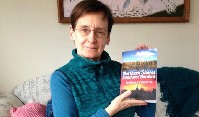 Janet Kurtz Holding Her New Book
