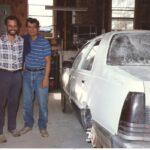 Samir teaches Joe auto body work at the Jubilee Partners refugee center.
